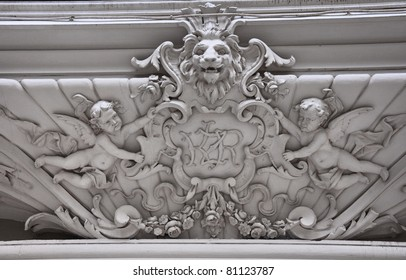 Stone bas-relief of lion and angels in Lviv, Ukraine.
