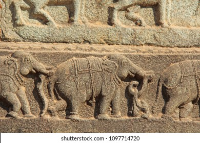 Stone bas-reliefs on the walls in Temples Hampi. Carving stone ancient background. Carved figures made of stone. Unesco World Heritage Site. Karnataka, India. Royal enclosure.