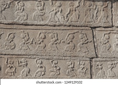 Stone bas-reliefs on the walls in Temples Hampi. Carving stone ancient background. Carved figures made of stone. Unesco World Heritage Site. Karnataka, India. Gray background. Royal enclosure.