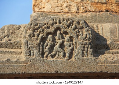 Stone bas-reliefs on the walls in Temples Hampi. Carving stone ancient background. Carved figures made of stone. Unesco World Heritage Site. Karnataka, India. Stone background. Royal enclosure.