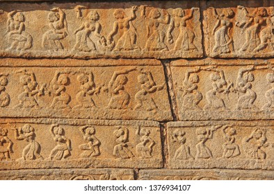 Stone bas-reliefs on the walls in Temples Hampi. Carving stone ancient background. Carved figures made of stone. Unesco World Heritage Site. Karnataka, India. Beige background. Royal enclosure.