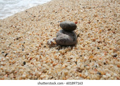 Stone at the beach in sand / grit