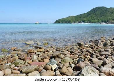 Stone with beautiful beach and blue sky at Koh Koh hin-ngam in Andaman Sea near Koh Lipe,Tarutao national park and Koh Lipe ,Satun Province ,Thailand