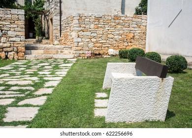 Stone bench in modern garden - Old Mediterranean town in Croatia