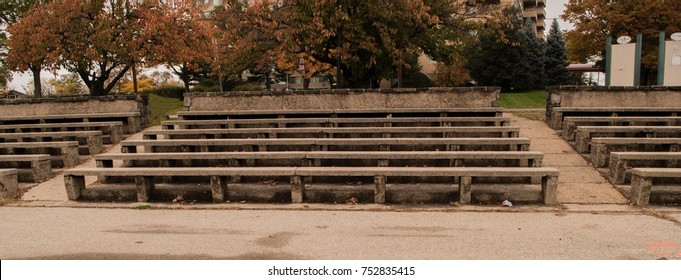 Stone bleachers in park setting