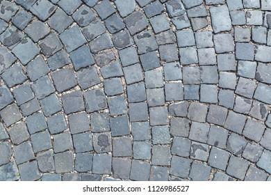 Stone block road pavement background.