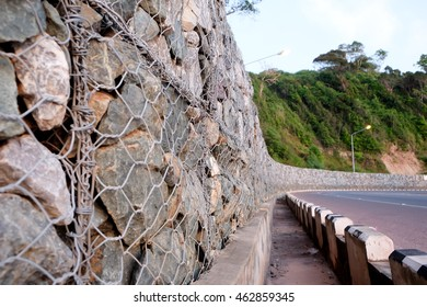 The stone blocks to prevent landslides in seismic rock band Crimea. Strengthening mountain landslide slopes. Stone Ridge is strapped with wire mesh to protect against landslides
