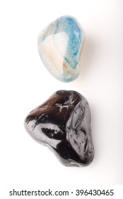 Stone blue agate and black tourmaline on a white background.