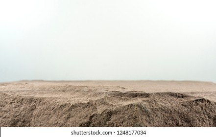 Stone board empty table in front of blurred background. Perspective brown rock over blur white background.