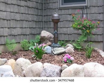 Stone Bordered Landscape Fountain and Flowers