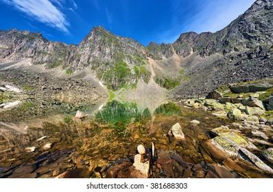 Stone bottom clear mountain lake in highlands . Eastern Siberia. Russia