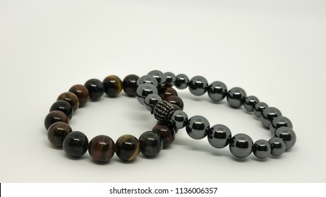 Stone bracelet made from lucky stone placed on white background.