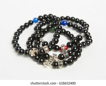 Stone bracelets on white background