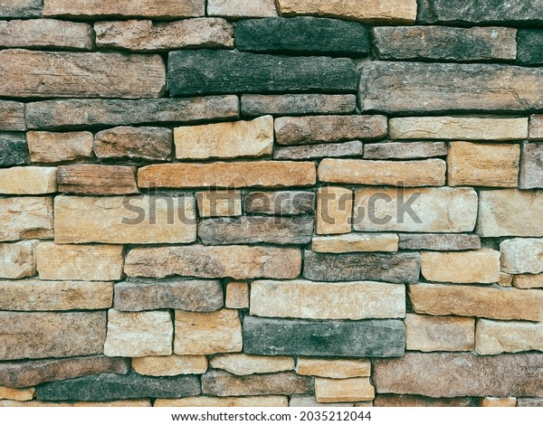 stone brick building facade wall cut and irregular shapes rock structure