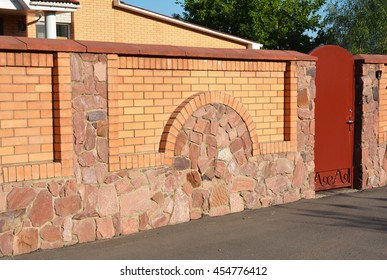 Stone, Brick And Metal Fence With Door Of Modern Style Design Decorative  Cracked Real Stone