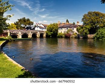Stone bridge across river;  beautiful, ancient stone bridge crosses river in Christchurch, Dorset
