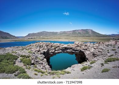 Stone bridge in Caviahue Lake, Patagonia. Land of dinosaurs. Provincial Park of Copahue.