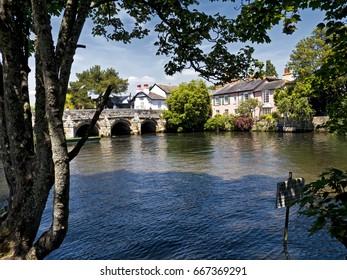 Stone bridge crosses river;  beautiful, ancient stone bridge crosses river in Christchurch, Dorset