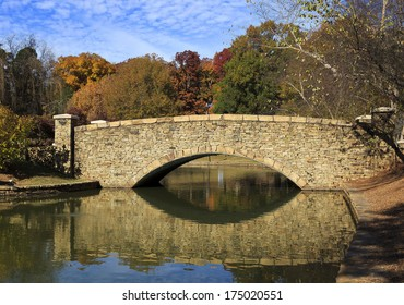 The stone bridge at Freedom Park in Charlotte, NC in the fall season