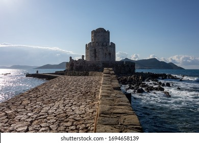 Stone bridge leading to the Methoni Castle in sunny weather during early morning hours in Greece