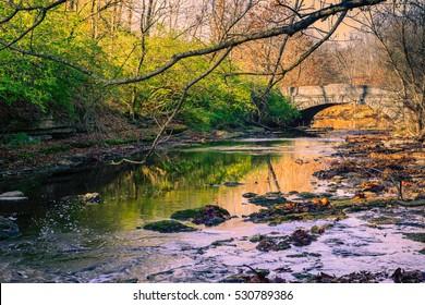 Stone bridge over Beargrass Creek at Seneca Park Louisville KY. - Shutterstock ID 530789386