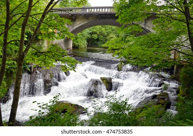 Stone bridge over forest and waterfalls