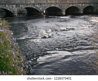 A stone bridge over the Garavogue River in the town of Sligo