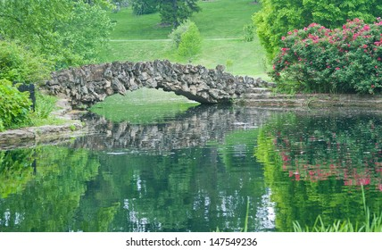 Stone Bridge Over Reflecting Pond