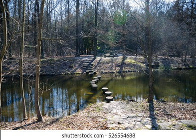 stone bridge over a river in the forest