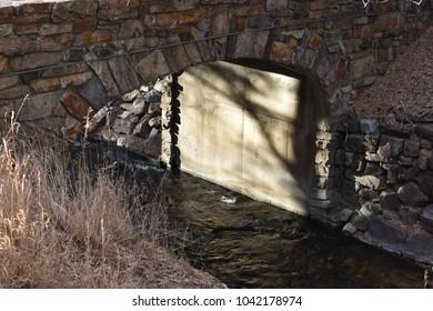 Stone bridge over stream.