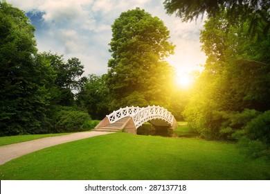 Stone bridge over stream. sunrise