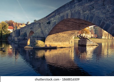 Stone bridge in Pisek, south Bohemia, the oldest bridge in Central Europe across the river Otava - Shutterstock ID 1868816509
