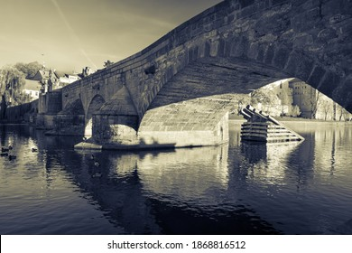 Stone bridge in Pisek, south Bohemia, the oldest bridge in Central Europe across the river Otava - Shutterstock ID 1868816512