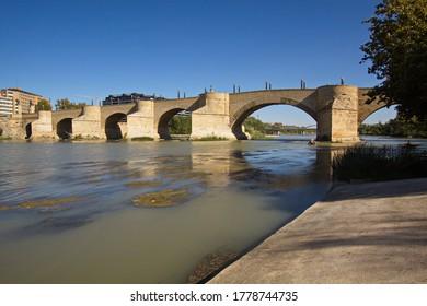 Stone bridge Puente de Piedra over the river Ebro in Zaragoza,Spain,Europe