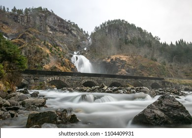 Stone bridge river waterfall Latefossen Norway