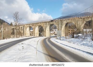 Stone bridge in winter, Ukraine. Rural view.