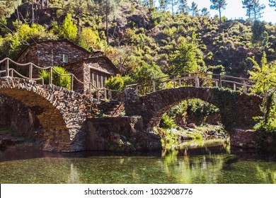 Stone bridges over the river and little cottage, Foz d'Egua, Portugal