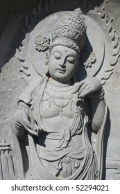 A stone buddah statue filling the frame
