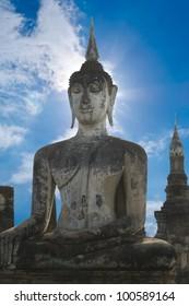 Stone Buddha with blue sky, Thailand