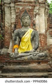 Stone Buddha with brick background in Ayutthaya of Thailand