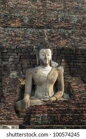 Stone Buddha with brick background, Thailand