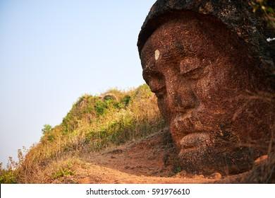 Stone Buddha Head at the mountain near Gokarna