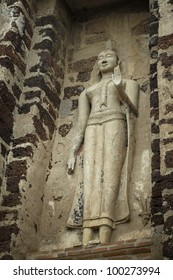Stone Buddha on the wall, looking up, in Ayutthaya of Thailand