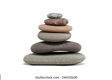 Stone cairn made from a variety of colorful Lake Superior rocks.  Studio shot.  Isolated on white.