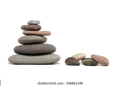 Stone cairn made from a variety of colorful Lake Superior rocks.  Four extra stones. Studio shot.  Isolated on white.