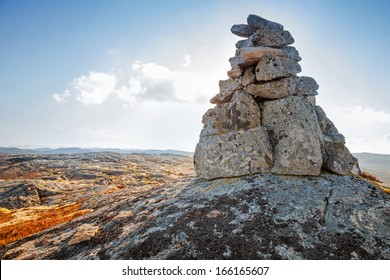 Stone cairn as a navigation mark on the top of Norwegian mountain