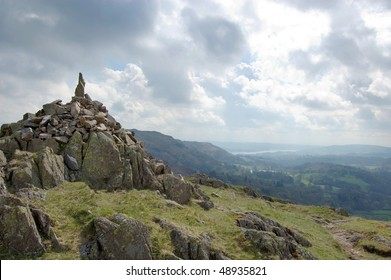 Stone cairn on Silver How near Grasmere, with Windermere in background