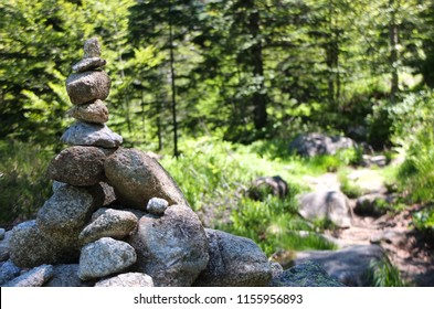 Stone cairn showing the way on the GR10 trail in the Pyrenees, France