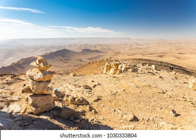 Stone cairn trail sign top summit peak desert mountains hiking Israel nature landscape view.