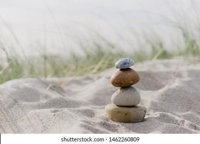 stone cairns at the beach, baltic sea